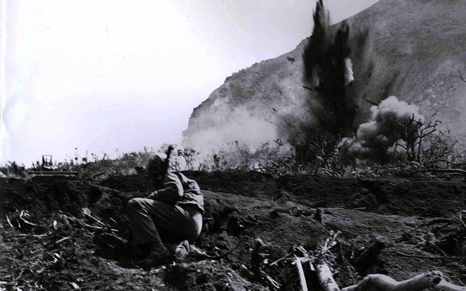 A Japanese position at the base of Mount Suribachi is eliminated by a high-explosive charge set off by the invading Marines during the Battle of Iwo Jima in this undated photo from 1945.