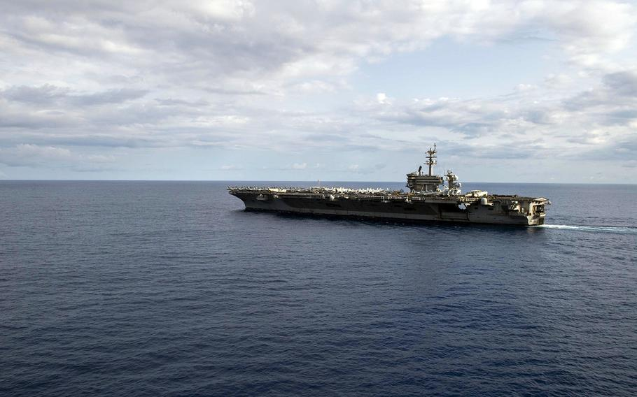 The aircraft carrier USS Theodore Roosevelt steams in the Philippine Sea, March 24, 2020.