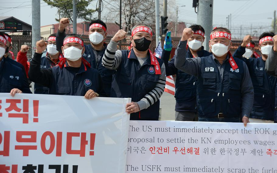 Members of the South Korean employees' union protest the U.S. Forces Korea furlough outside the main gate at Camp Humphreys, South Korea, Wednesday, April 1, 2020.