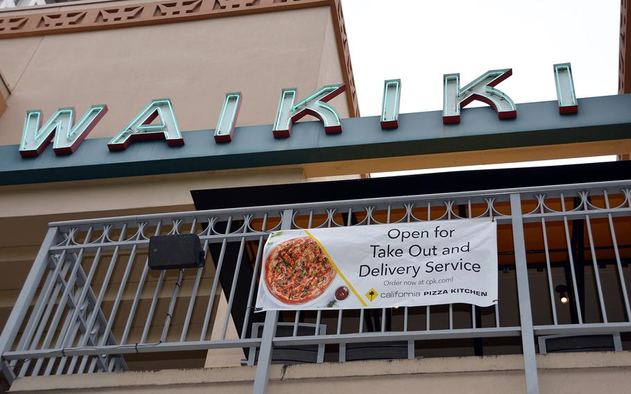 With a ban on sit-down dining, some eateries in Waikiki, Hawaii, still offer take-out and delivery meals.