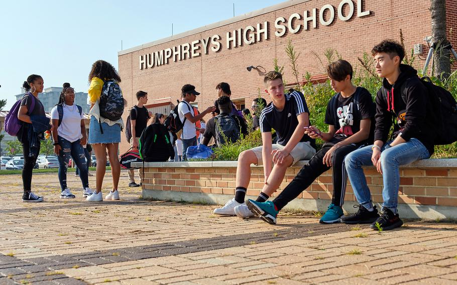 Students connect with friends outside Humphreys High School at Camp Humphreys, South Korea, Aug. 26, 2019.