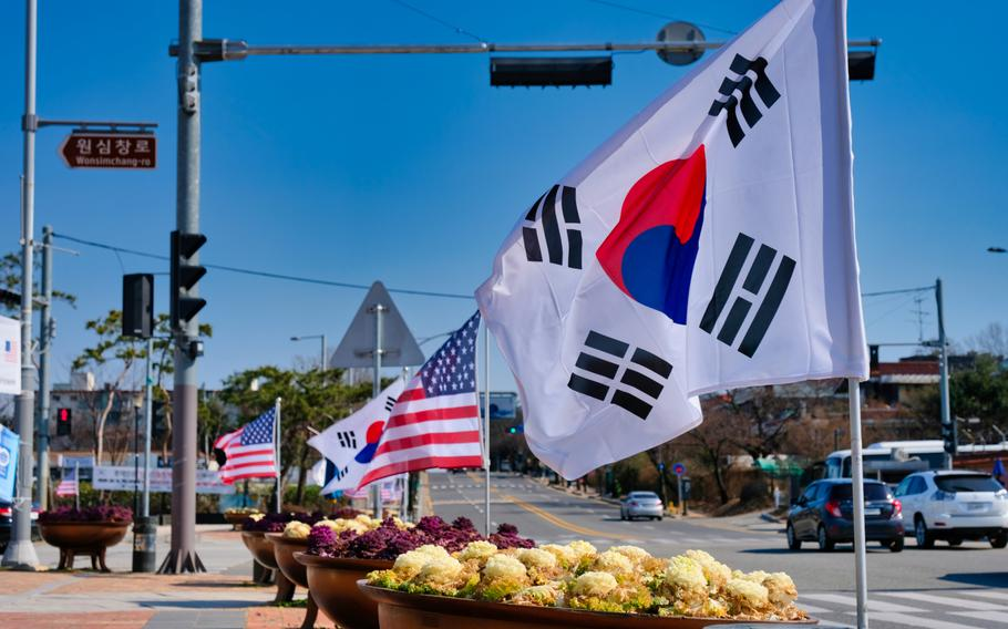 American and South Korean flags flap in the breeze outside Camp Humphreys, South Korea, March 16, 2020.