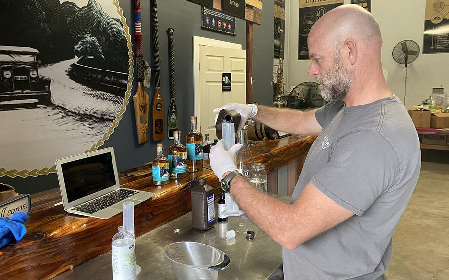 Eric Dill prepares a batch of ad hoc hand sanitizer at Ko'olau Distillery on Oahu, where he and co-owner Ian Brooks have stepped away from making whiskey temporarily to fill a need during the coronavirus pandemic.