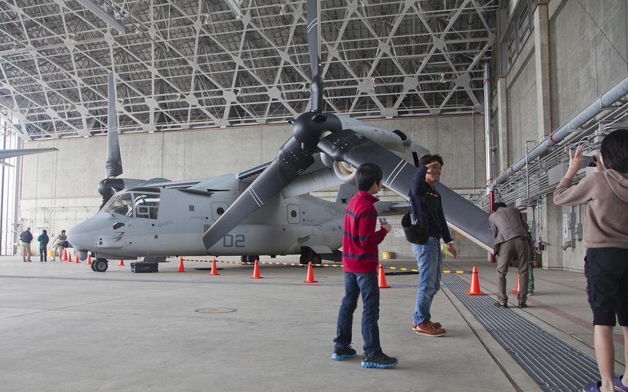 Okinawans tour Marine Medium Tiltrotor Squadron 265's hangar during an open house at Marine Corps Air Station Futenma, Okinawa, Japan, March 3, 2013.