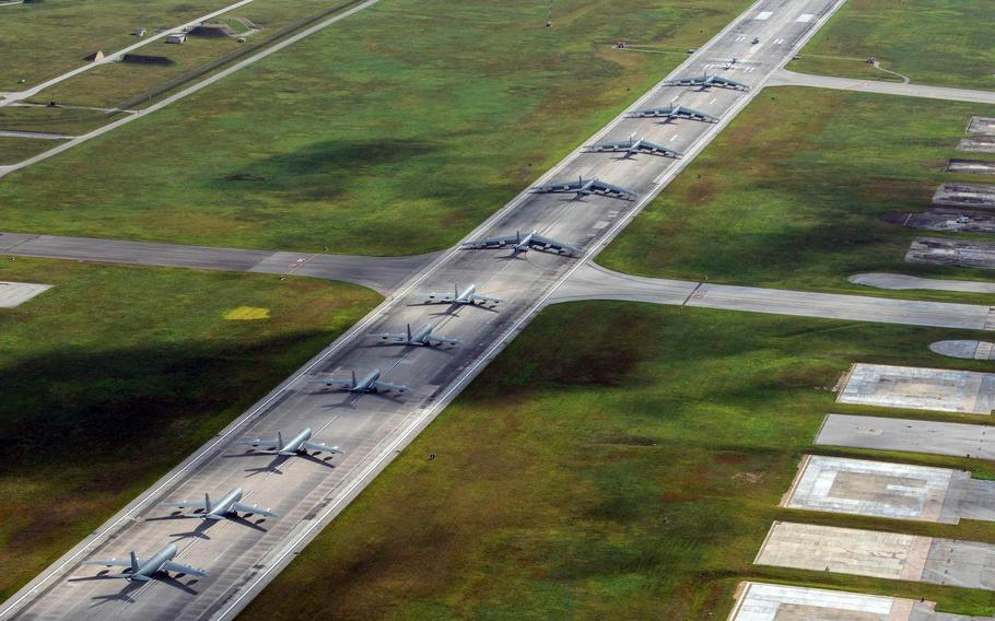 """A Navy MH-60S Knighthawk, Air Force RQ-4 Global Hawk, Navy MQ-4C Triton, Air Force B-52 Stratofortresses and KC-135 Stratotankers perform an """"elephant walk"""" at Andersen Air Force Base on Monday, April 13, 2020."""