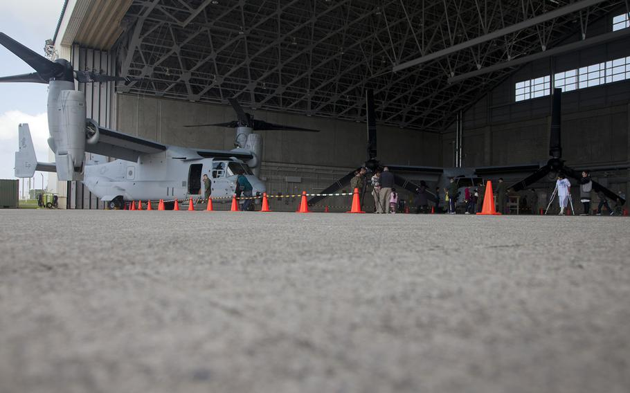 Locals tour an Osprey hangar at Marine Corps Air Station Futenma, Okinawa, during an open house on March 3, 2013.