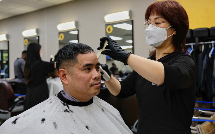 Maj. Bernard Bunal gets a haircut after at Camp Humphreys, South Korea, Saturday, April 18, 2020. Barbershops reopened that day after being closed for nearly three weeks because of the coronavirus pandemic.