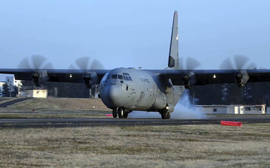 A C-130J Super Hercules touches down on a taxiway during assault landing training late last month at Yokota Air Base, Japan, March 26, 2020.