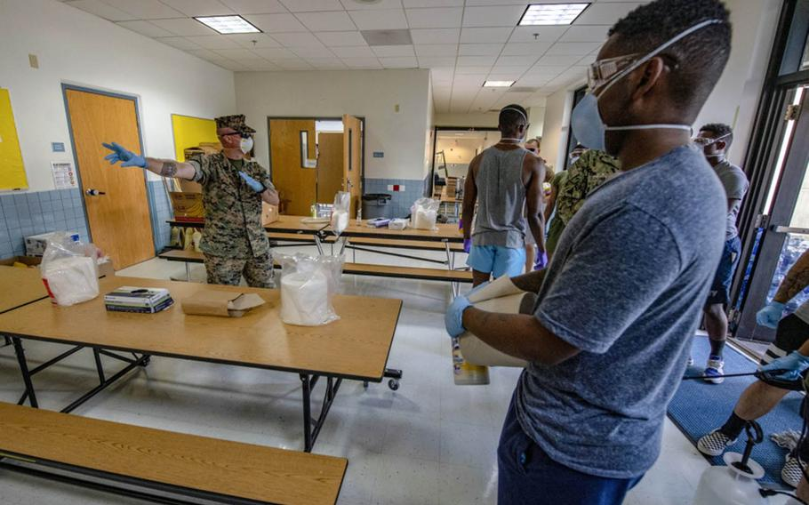 Sailors and Marines from 3rd Medical Battalion, 3rd Marine Logistics Group, sterilize a building at  Naval Base Guam on April 9, 2020.