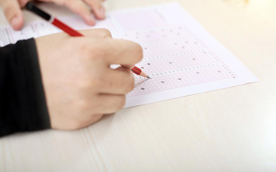 College Board is pressing ahead with a plan to administer Advanced Placement tests simultaneously worldwide.