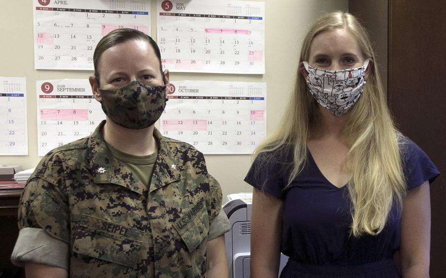 Lt. Col. Petra Seipel, left, executive officer for the III Marine Expeditionary Force Information Group, and Julie Ferns, a Marine spouse, show off their handmade masks at Camp Hansen, Okinawa, Tuesday, April 21, 2020.