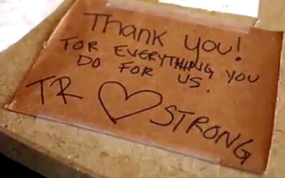 This screen shot from a video shows a message from a USS Theodore Roosevelt sailor to the Marines on Guam, showing appreciation for the support the the sailors have received.