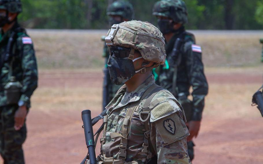 A soldier assigned to 25th Infantry Division stands at attention March 30, 2020, at Krabi, Thailand, during the opening ceremony of the Hanuman Guardian exercise.