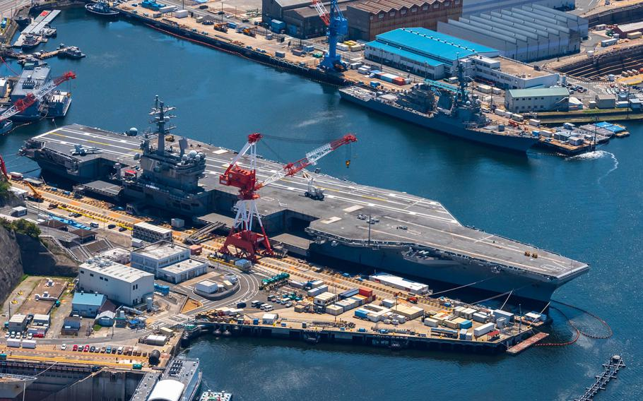 The aircraft carrier USS Ronald Reagan is seen from the air at Yokosuka Naval Base, Japan, April 25, 2020.