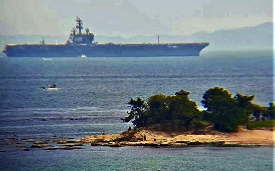 The aircraft carrier USS Ronald Reagan departs Yokosuka Naval Base, Japan, for sea trials on Tuesday, May 5, 2020.