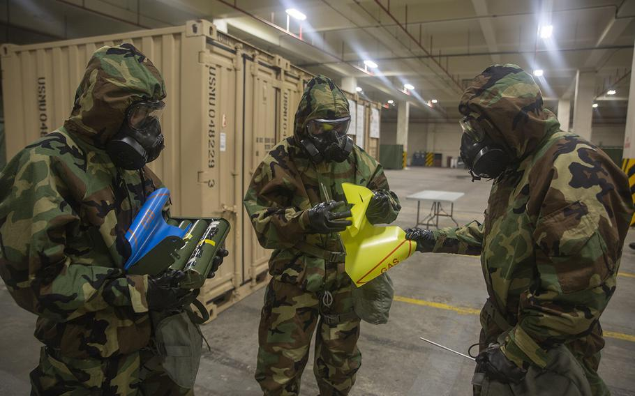 Marines with Combat Logistics Regiment 35 participate in a reconnaissance, surveillance and decontamination training course at Camp Kinser, Okinawa, Japan, July 17, 2018.