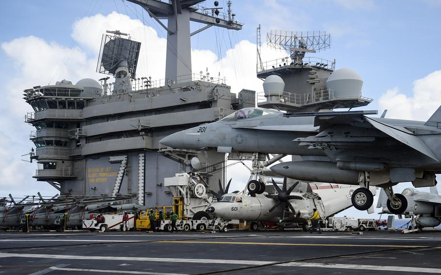 An F/A-18E Super Hornet lands aboard the aircraft carrier USS Theodore Roosevelt in the Philippine Sea, May 25, 2020.