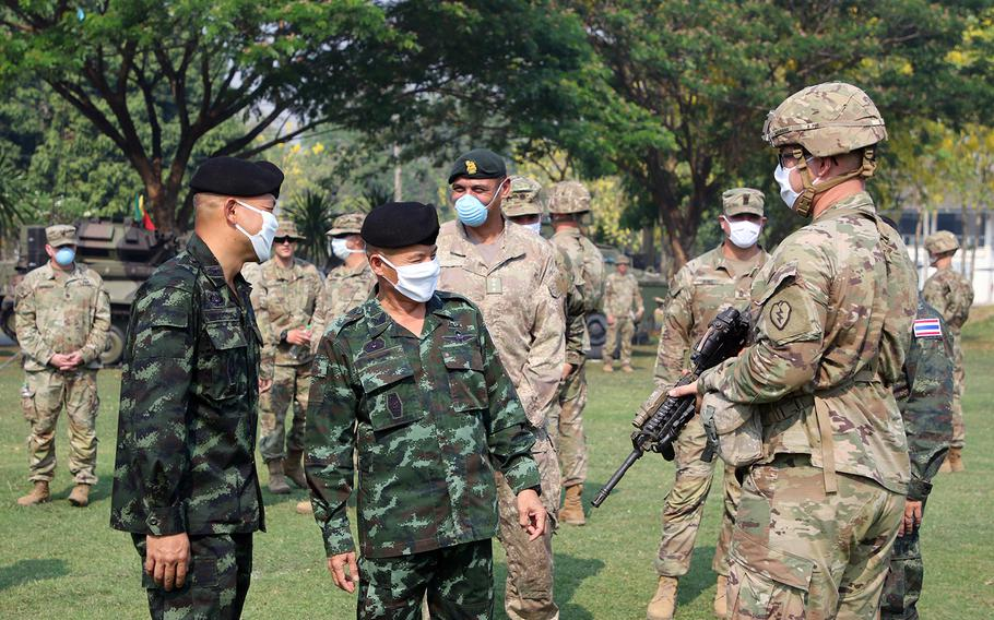 Royal Maj. Gen. Takad Lordsiri speaks with a U.S. soldier during the opening ceremony of the Hanuman Guardian exercise, part of Pacific Pathways,  at Fort Kanchanaburi, Thailand, March 31, 2020.
