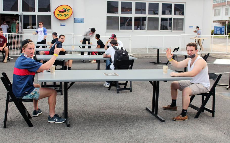 Sailors at Sasebo Naval Base demonstrate social distancing at a beer garden that opened outside the base enlisted club on Friday, May 29, 2020.