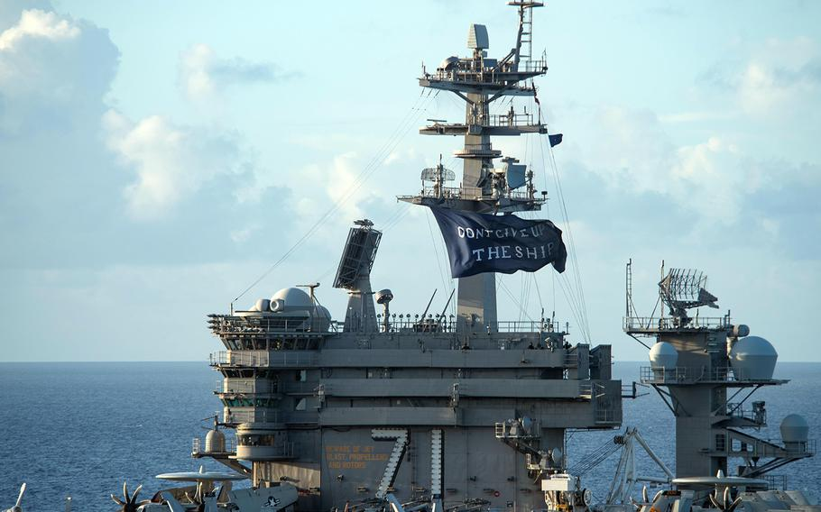 The aircraft carrier USS Theodore Roosevelt flies a replica of Capt. Oliver Hazard Perry's Don't Give Up the Ship flag in the Philippine Sea, June 3, 2020.