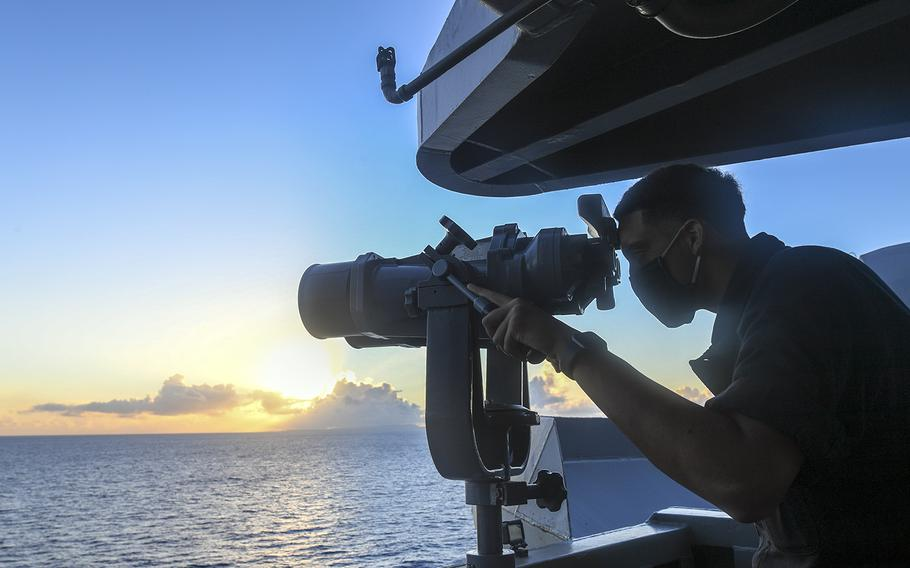 A sailor aboard the aircraft carrier USS Theodore Roosevelt searches for surface contacts in the Philippine Sea, June 3, 2020.