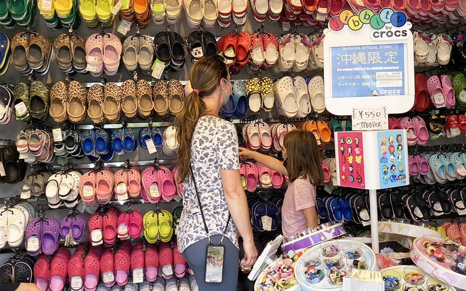 Marine Corps spouse Kristin Edick and her daughters Ellisyn and Logan shop at American Village in Chatan, Okinawa, Thursday, June 4, 2020.