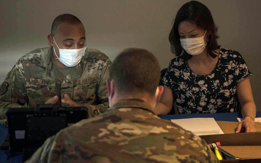 Staffers from the personal property office at Yokota Air Base in Tokyo help an airman set up the transfer of his household goods, Friday, June 5, 2020.