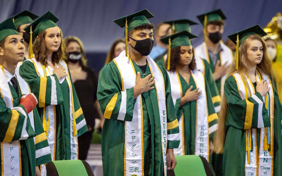 Seniors from Robert D. Edgren Middle High School stand for the U.S. and Japanese national anthems during their commencement ceremony at Misawa Air Base, Japan, Friday, June 5, 2020.