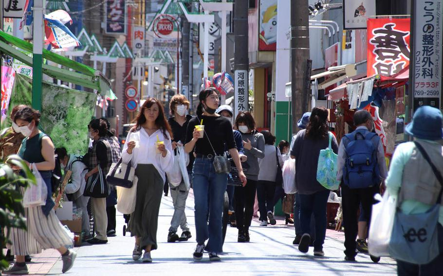 People stroll along a popular shopping street in Yokohama, Japan, May 11, 2020. U.S. Army Japan has relaxed coronavirus-related travel restrictions, but Yokohama and central Tokyo remain off limits.