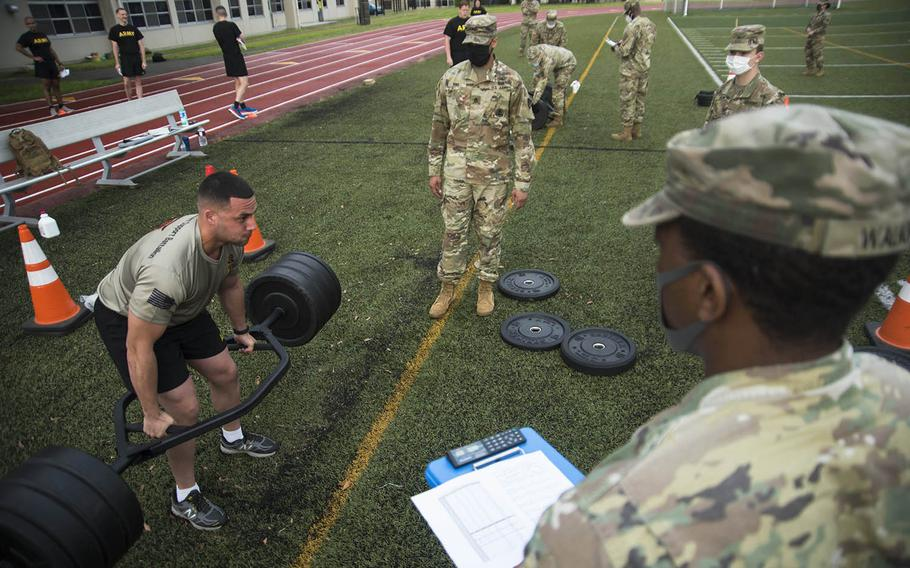 Army Sgt. Marino Cabral, 23, of New York, N.Y., takes part in a combat fitness test competition at Camp Zama, Japan, Monday, June 8, 2020.