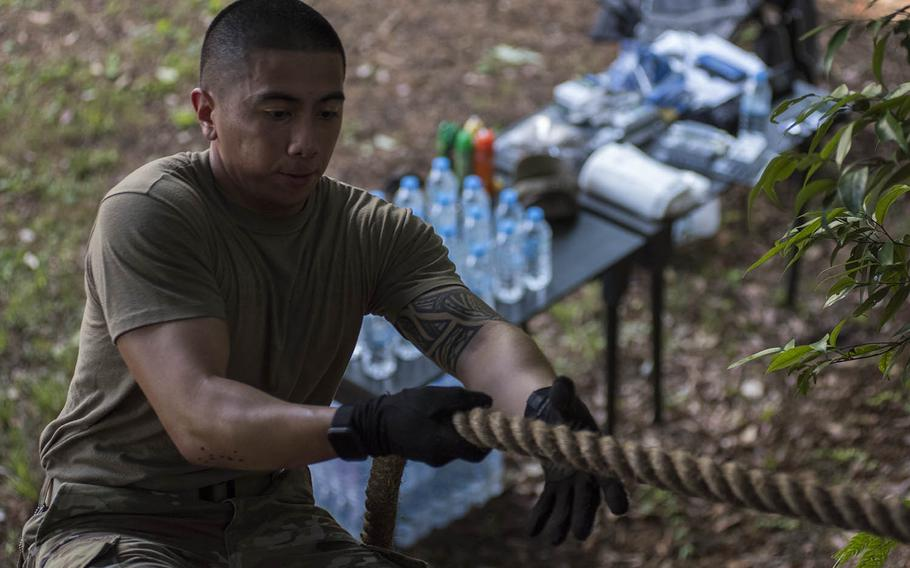 A soldier works through an obstacle course during a functional fitness test competition at Camp Zama, Japan, Tuesday, June 9, 2020.