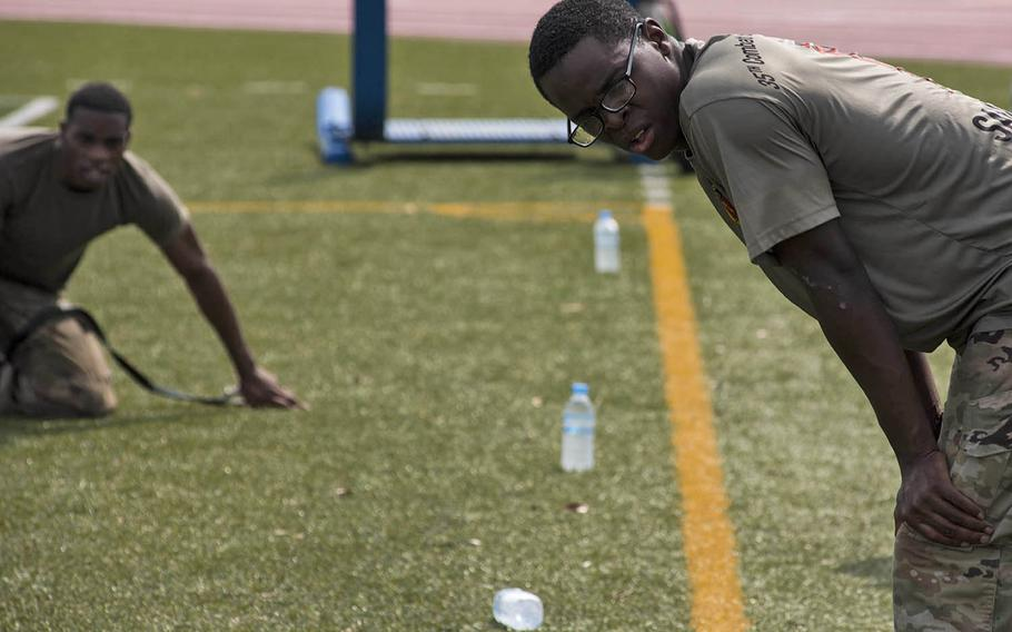 Soldiers catch their breath after completing a five-mile run with eight obstacle stations during an Army Week competition at Camp Zama, Japan, Tuesday, June 9, 2020.