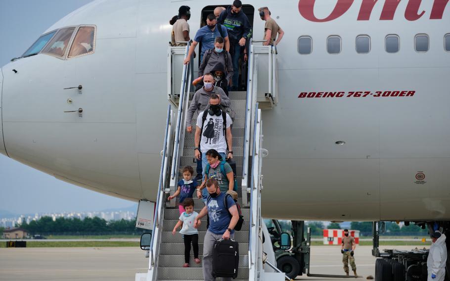 Passengers exit a Patriot Express flight at Osan Air Base, South Korea, Wednesday, June 10, 2020.
