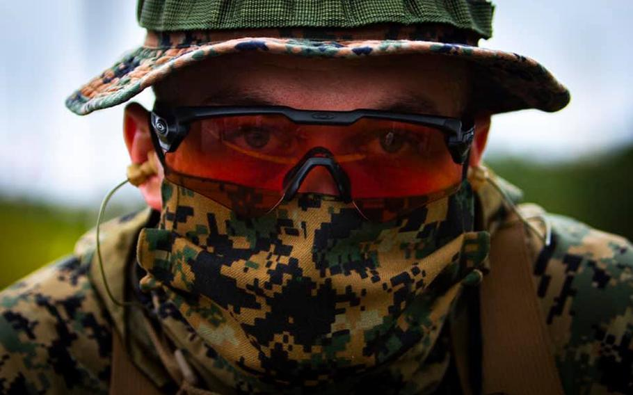 A Marine wears a mask during annual rifle qualifications at Camp Hansen, Okinawa, May 6, 2020.