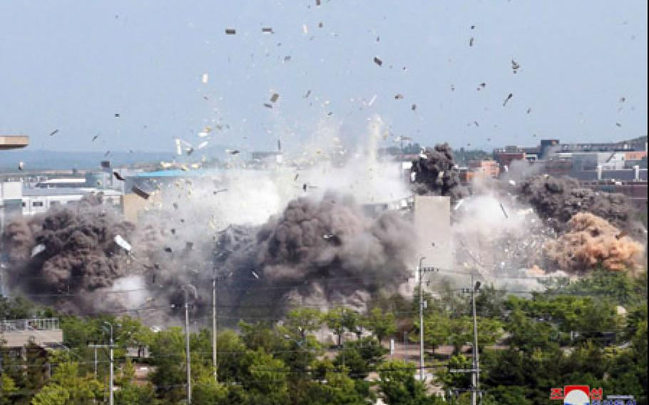 North Korea blows up a joint liaison office near the border with South Korea, Tuesday, June 16, 2020, in this image released by the Korean Central News Agency.