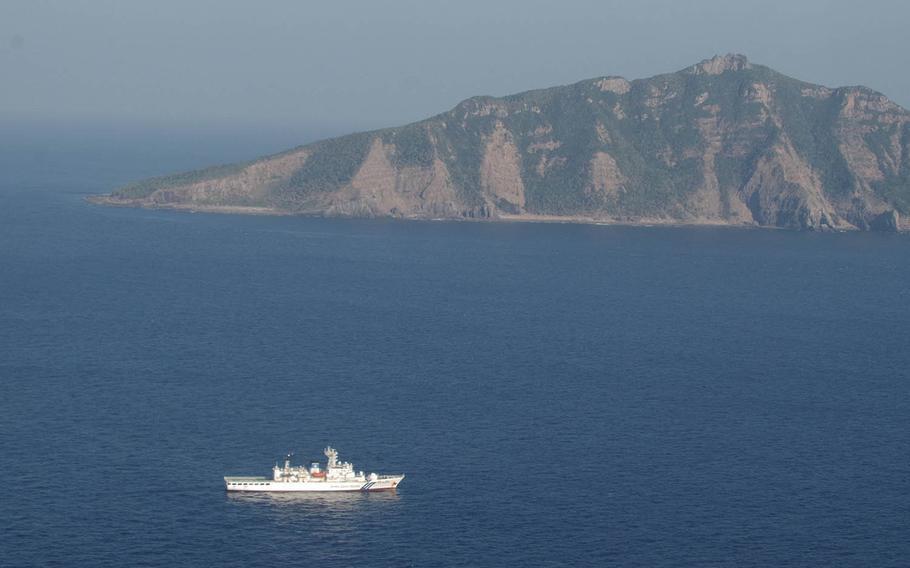A Japan Coast Guard vessel sails in the East China Sea near Uotsuri-jima, the largest island in the uninhabited Senkaku chain, in this undated photo.
