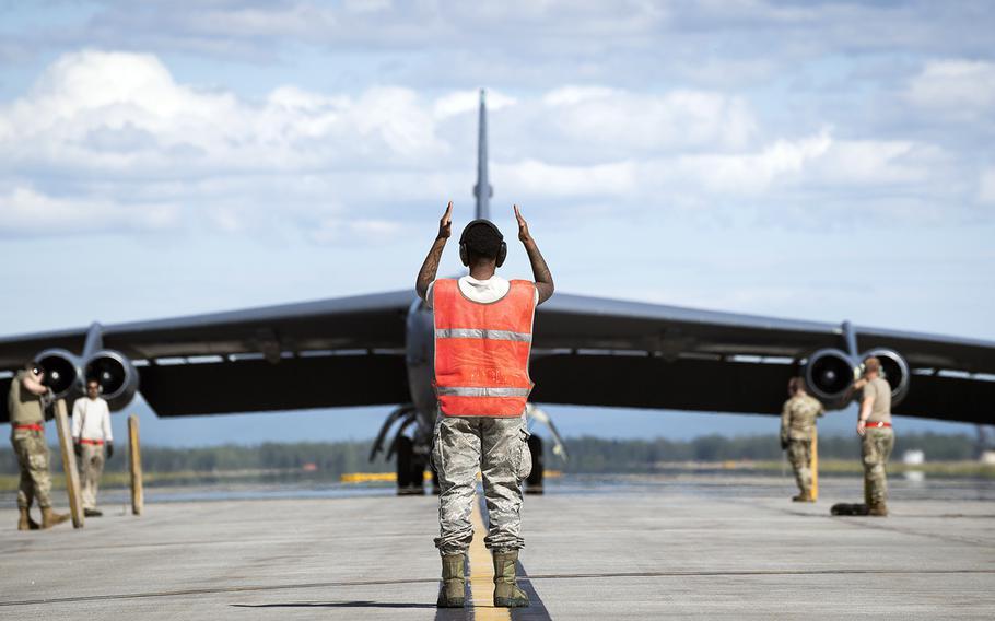 Senior Airman Jar'quayla Doss of the 96th Aircraft Maintenance Unit marshalls a B-52H Stratofortress at Eielson Air Force Base, Alaska, Wednesday, June 17, 2020.