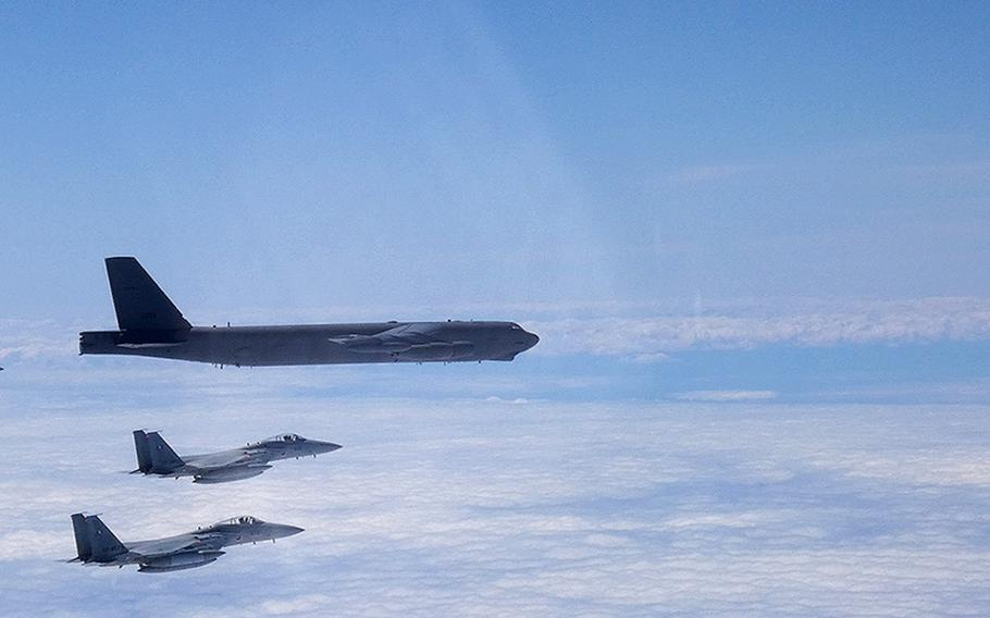A B-52H Stratofortress deployed from Barksdale Air Force Base, La., flies between Japan and Korea alongside two Japan Air Self-Defense Force F-15s, Tuesday, June 16, 2020.