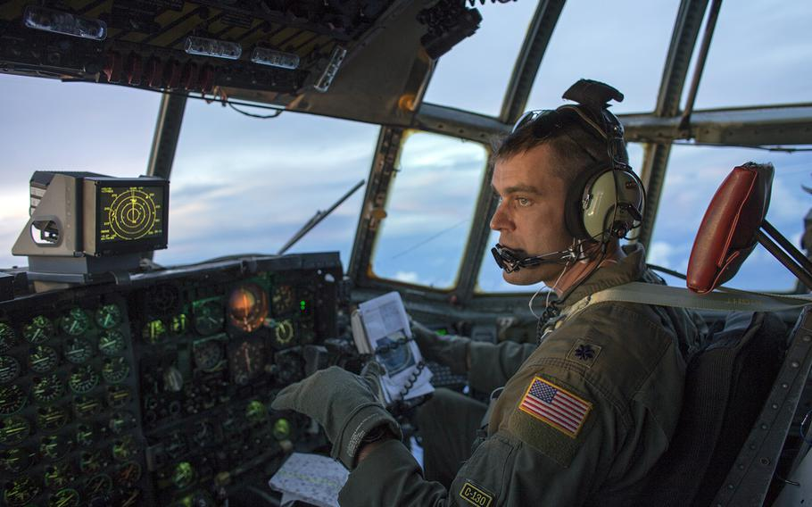 Then-Lt. Col. Andrew Campbell flies a C-130H during an Operation Christmas Drop mission over the Pacific Ocean, Dec. 9, 2015. Campbell, who is now a colonel, took command of the 374th Airlift Wing at Yokota Air Base, Japan, Monday, June 22, 2020.