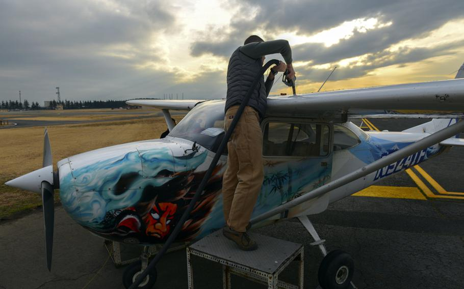 Then-Lt. Col Andrew Campbell fuels up a Yokota Aero Club plane while working on his single-engine pilot's license in February 2016. Campbell, who is now a colonel, took command of the 374th Airlift Wing at Yokota Air Base, Monday, June 22, 2020.