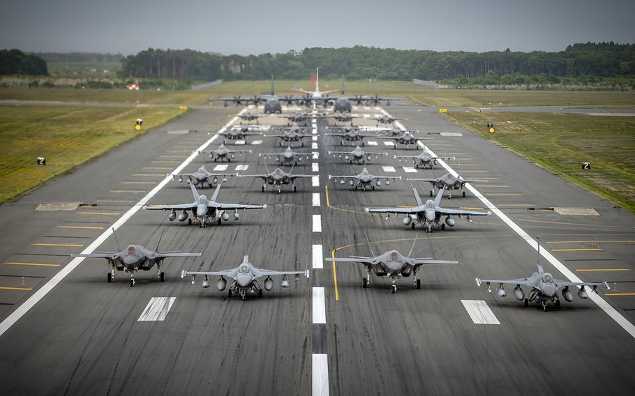 Twelve Air Force F-16CM Fighting Falcons, 12 Japanese F-35A Lightning II stealth fighters, two Navy EA-18G Growlers, a Navy C-12 Huron, two Air Force MC-130J Commando IIs and a Navy P-8 Poseidon participate in a show of force at Misawa Air Base, Japan, June 22, 2020.
