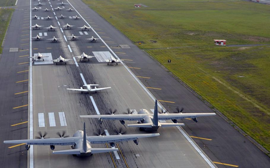 Military aircraft from the U.S. and Japan, including a dozen Japan Air Self-Defense Force F-35A stealth fighters, participate in an elephant walk at Misawa Air Base, Japan, June 22, 2020.