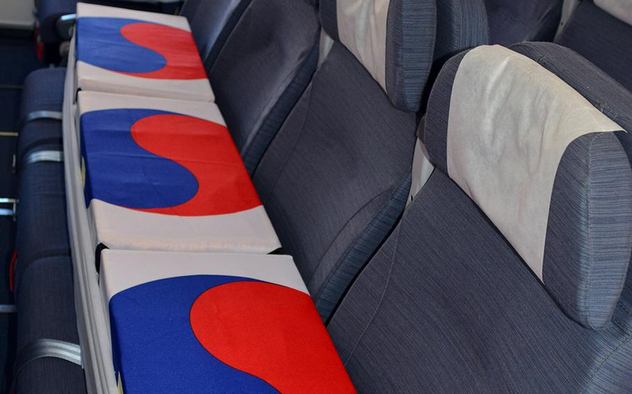 Boxes draped in South Korean flags and containing the remains of unidentified South Korean service members rest aboard a jet set to depart from Hawaii, Tuesday, June 23, 2020.