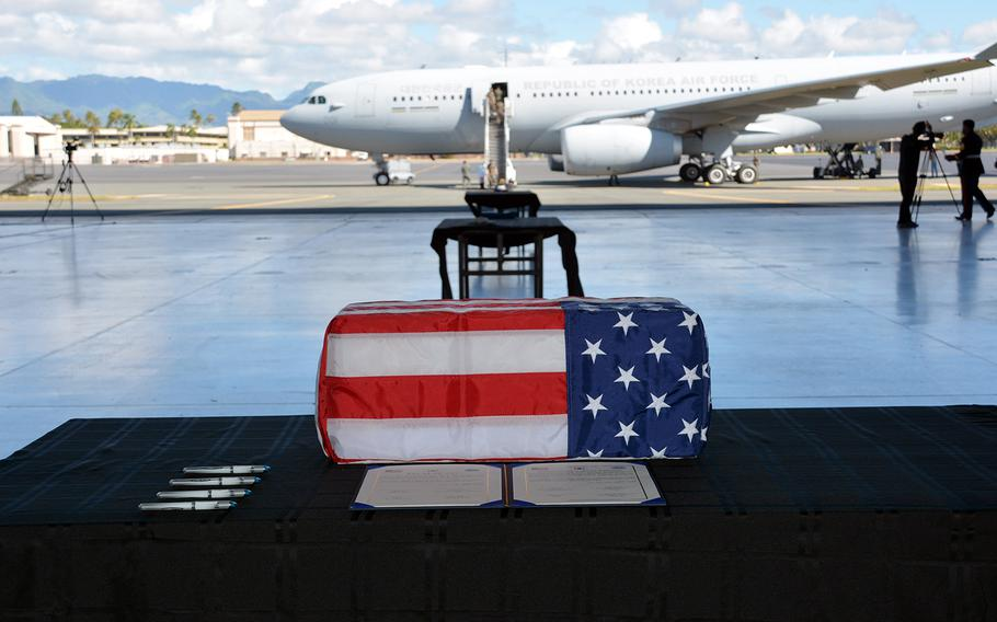 A box holding the remains of a South Korean service member rests in a hangar before being loaded onto a jet during a repatriation ceremony at Joint Base Pearl Harbor-Hickam, Hawaii, Tuesday, June 23, 2020.