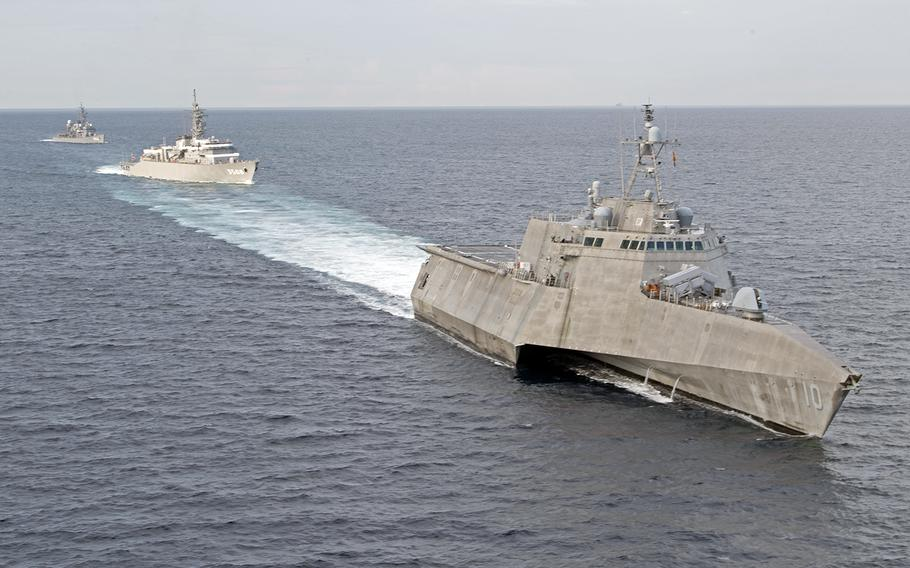 The littoral combat ship USS Gabrielle Giffords, right, trains with the Japan Maritime Self-Defense Force ships JS Kashima and JS Shimayuki in the South China Sea, Tuesday, June 23, 2020.
