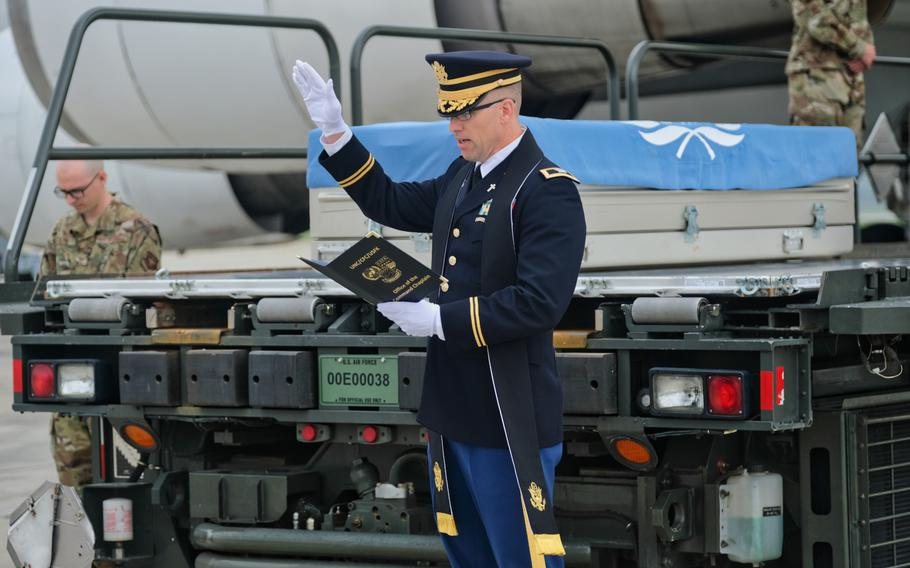 Col. David Bowlus, United Nations Command chaplain, leads a prayer during a repatriation ceremony at Osan Air Base, South Korea, Friday, June 26, 2020.