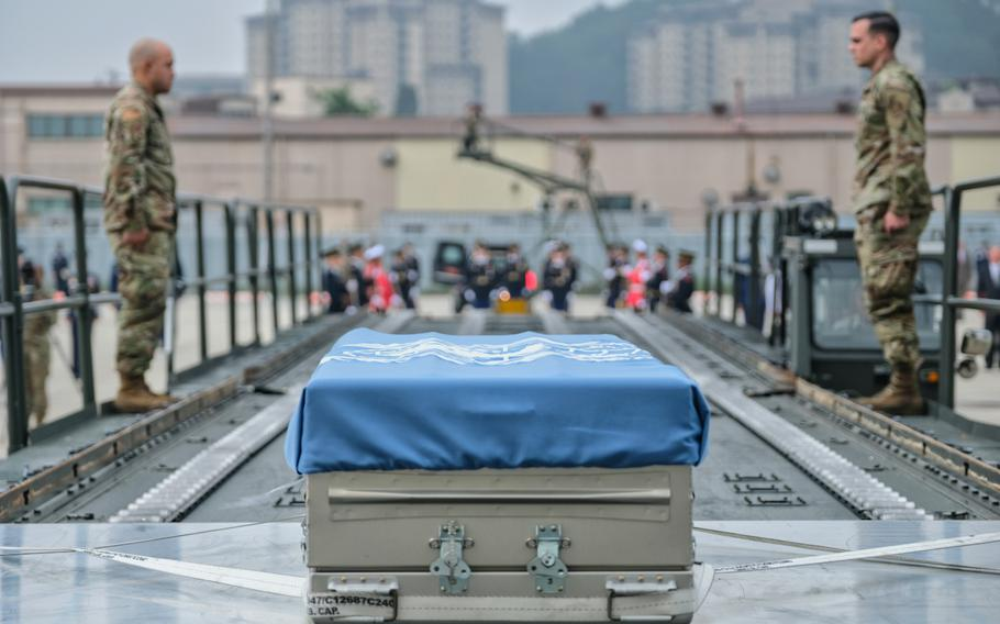 Draped in a United Nations flag, the remains of six unknown service members killed in the Korean War are pictured during a repatriation ceremony at Osan Air Base, South Korea, Friday, June 26, 2020.