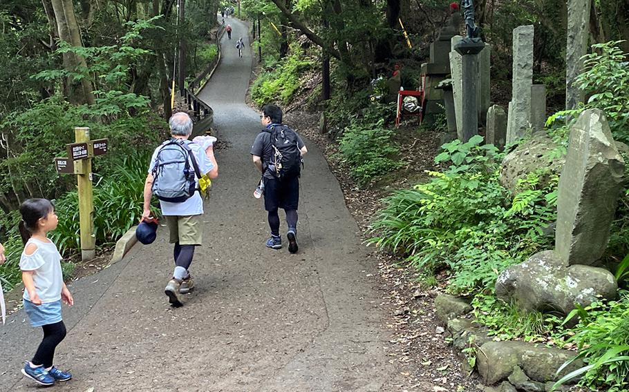 Families trek up Mount Takao, a popular hiking spot near Yokota Air Base, Japan, Saturday, June 27, 2020.