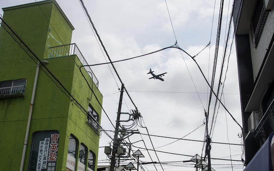 A C-130J Super Hercules assigned to Yokota Air Base in western Tokyo flies over the nearby city of Fussa, April 17, 2020.