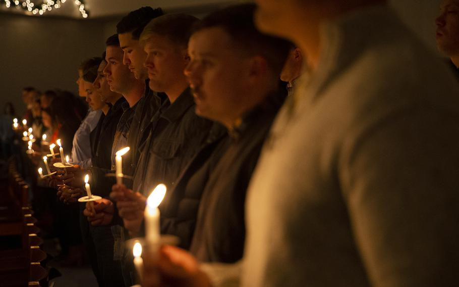 A candlelight vigil at Marine Corps Air Station Iwakuni, Japan, Dec. 6, 2019, honors Marines who died in a midair collision a year earlier.